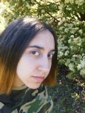 Bella - Me in my yard whenever I had my lip ring.