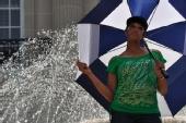 Sherrisse Johnson - Umbrella in the fountain